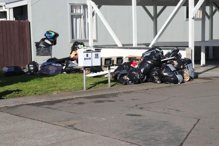 Rubbish strewn outside a Kāinga Ora flat complex in Napier.