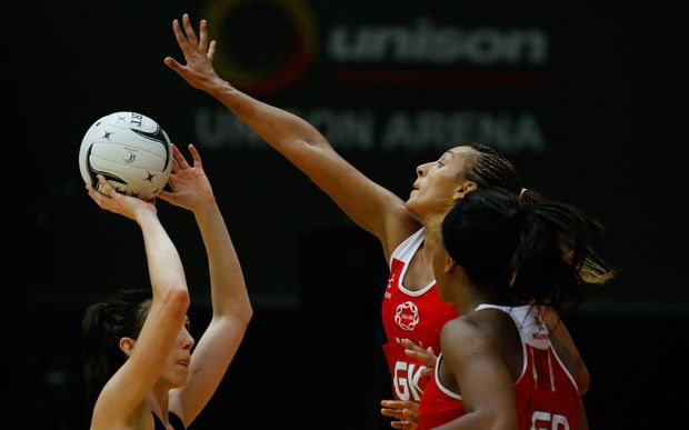 England's Geva Mentor and Silver Fern Bailey Mes clash in Rotorua in 2014.