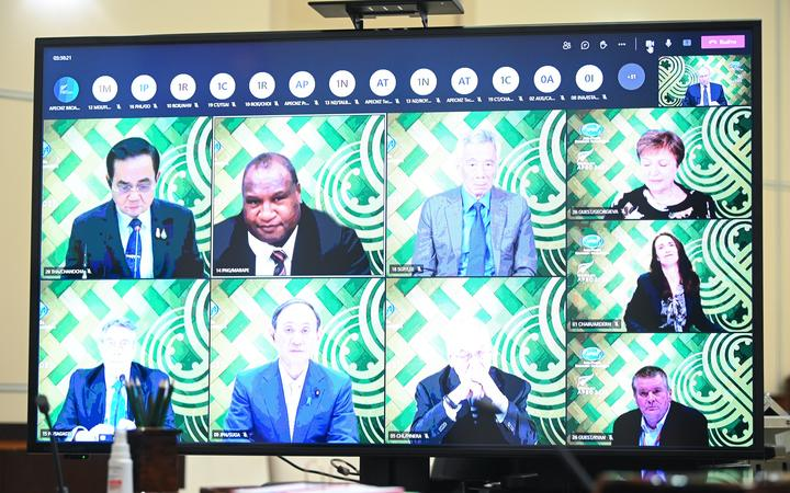 A screen shows attendees of an informal meeting of APEC Economic Leaders (the Asia-Pacific Economic Cooperation forum) via videoconference.