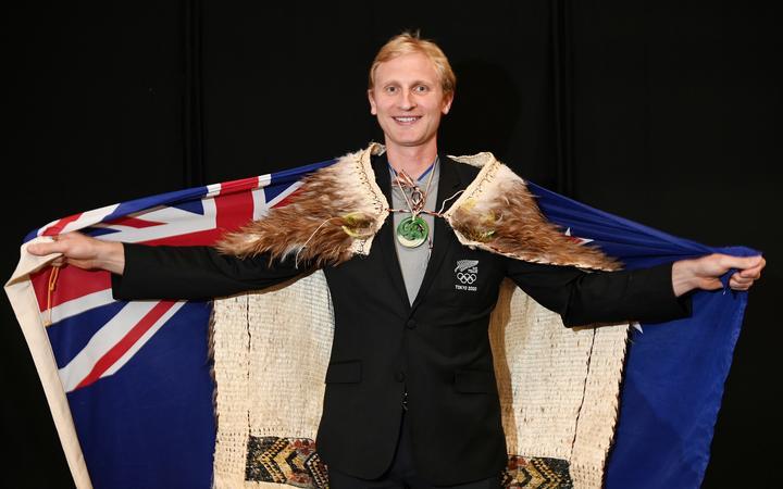 Hamish Bond one of two New Zealand flagbearers, along with Sarah Hirini.