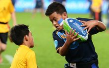 Kids playing rippa rugby
