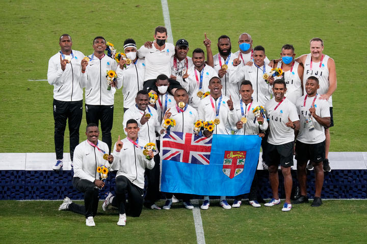 Fiji celebrate their Olympic gold medal.