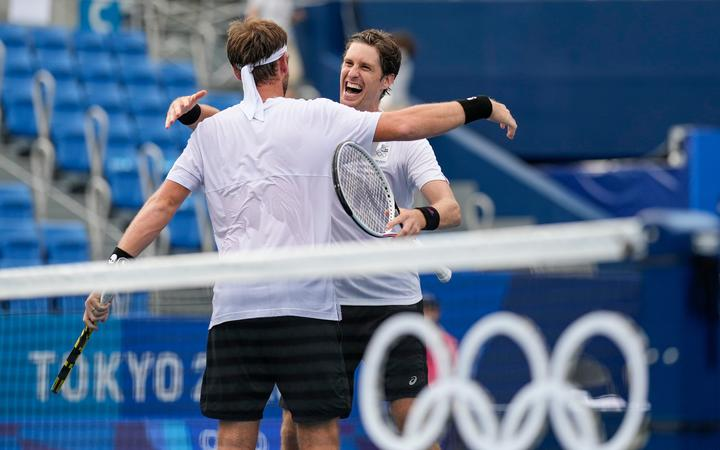New Zealand's Michael Venus (left) hugs Marcus Daniell after they defeated Americans Krajicek / Sandgren to win the bronze medal in the men's doubles at Ariake Tennis Park, Tokyo 2020 Olympic Games. Friday 30 July 2021.