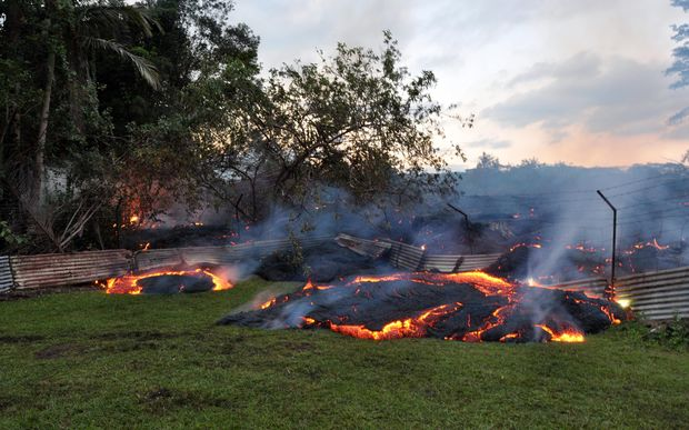 Lava that has pushed through a fence marking a property boundary in Pāhoa village in Hawaii.