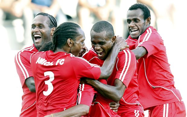 Amicale players celebrate a goal