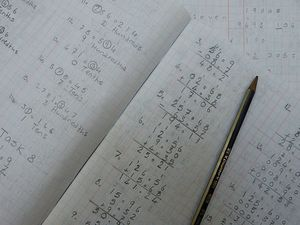 Open maths book with workings