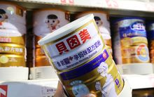 A customer shops for a tin of Beingmate 'mommy' formula in Xuchang, China.