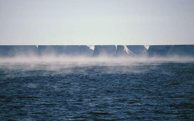 Frost smoke rises from the sea off the Ross Ice Shelf in Antarctica.