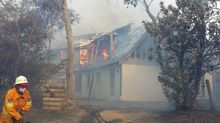 Houses alight at the scene of the bushfire in Katoomba.