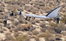 A National Transportation Safety Board team surveys the tail section from the crashed Virgin Galactic SpaceShipTwo.