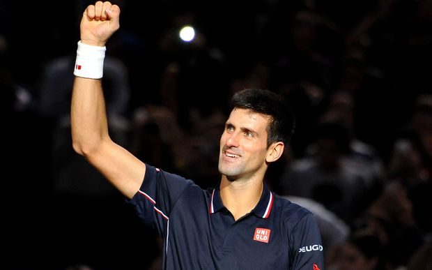 Novak Djokovic celebrates winning in Paris.