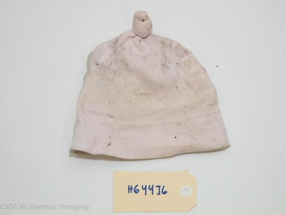 A police photo of a newborn baby's clothes was found dead at the Auckland Recycling Facility.