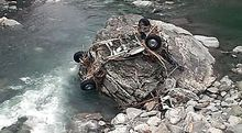 Part of the couple's vehicle found in the Haast River.