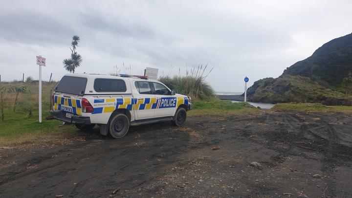 Police vehicle parked at Kiritehere Beach.