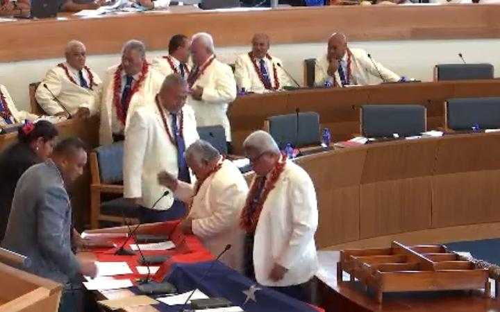 Leader of the HRPP, Tuilaepa Dr Sailele Malielegaoi, leads the swearing in of HRPP MPs in Parliament
