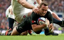 Aaron Cruden goes over for a try against England.