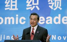 Chinese Foreign Minister Wang Yi speaks at a press conference in Beijing on 8 November.