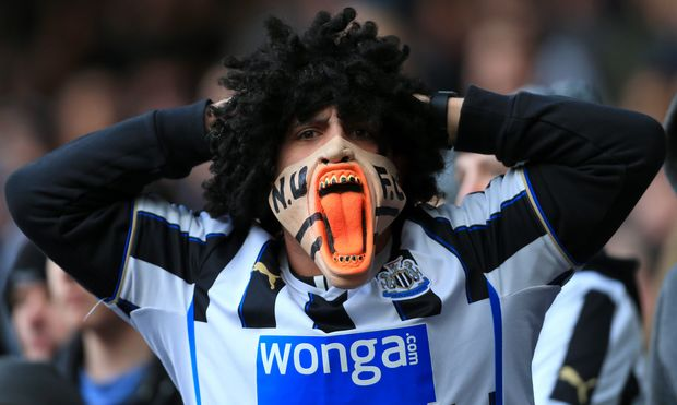 Premier League - A Newcastle fan wearing an angry mask.