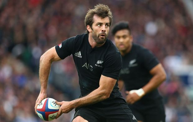 The All Blacks centre Conrad Smith in action against England.