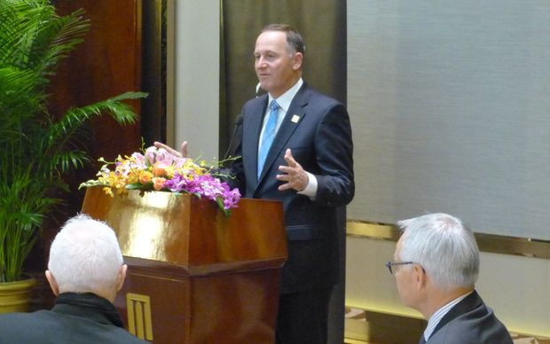 John Key at a breakfast meeting for New Zealand chief executives and youth delegates in Beijing.