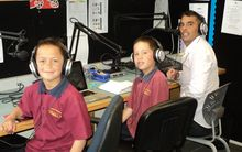 Deputy principal Tane Bennett and students broadcastiong Te Reo lessons.