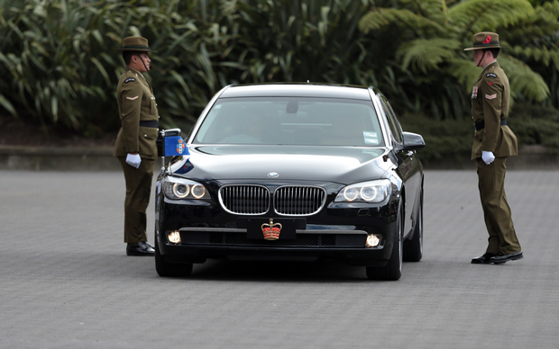 The Governor General car pulls up at Armistice Day celebrations.