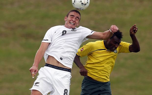 Vanuatu's Brian Kaltack fighting for possession against the All Whites.
