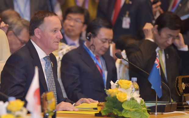 Prime Minister John Key, left, at the East Asian Summit Plenary Session in Myanmar's capital Naypyidaw.
