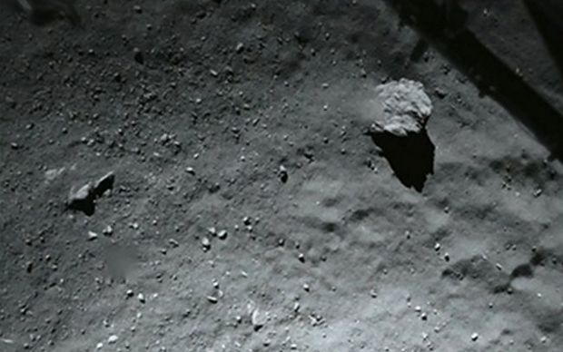 A photo by the ROLIS (Rosetta Lander Imaging System) instrument shows the surface of the comet during Philae's descent.