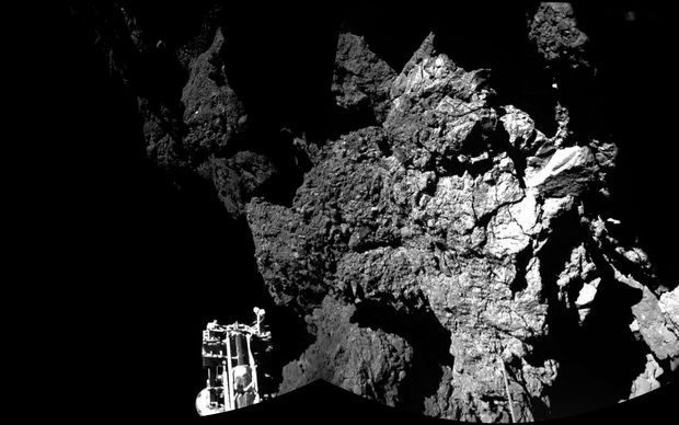 An image from the mission shows the surface of Comet 67P/Churyumov-Gerasimenko - and one of Philae's three feet.