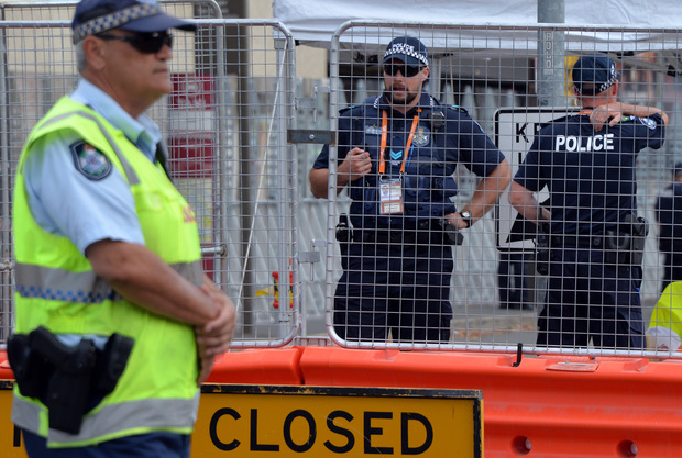 Queensland police stand guard outside summit venue Brisbane Exhibition and Convention Centre.