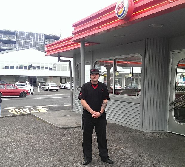 Hamilton Burger King worker, Brett Patterson, stands outside the store.
