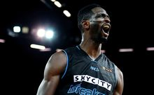 Ekene Ibekwe reacts after a dunk at Vector Arena