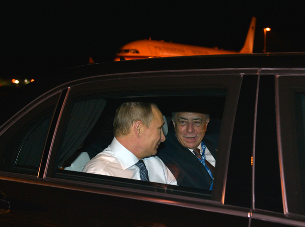 Russian President Vladimir Putin and Russian Ambassador to Australia Vladimir Morozov during the welcoming ceremony in Brisbane.