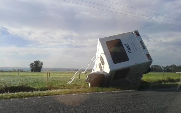 A campervan blew over in strong wind this morning on a road north of Kaikoura.