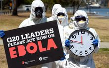 Protestors call for further action to fight Ebola in Brisbane on 15 November.