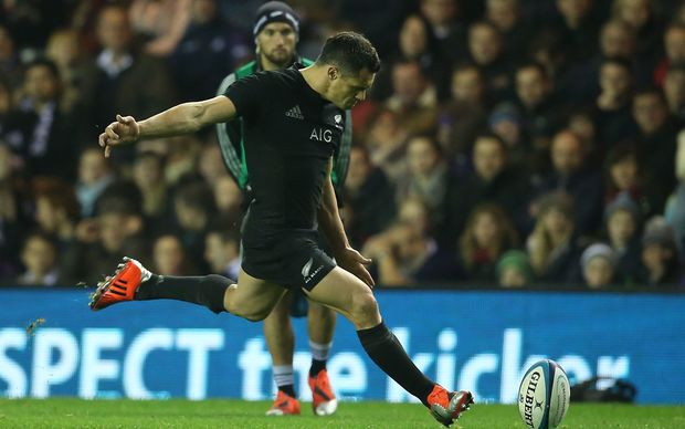 Dan Carter kicks a penalty as Aaron Cruden watches from the sidelines