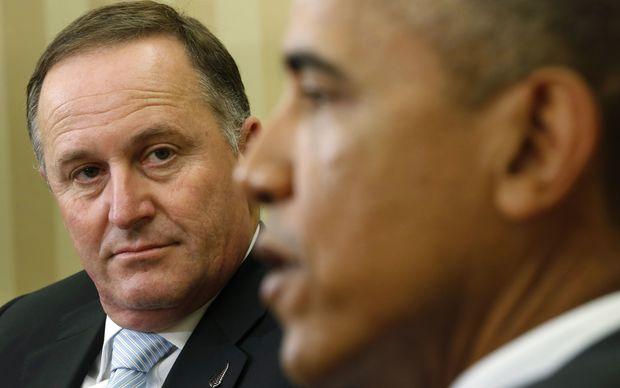 U.S. President Barack Obama (R) speaks as New Zealand's Prime Minister John Key looks on in the Oval Office of the White House in Washington June 20, 2014.
