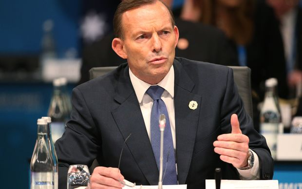 Australia's Prime Minister Tony Abbott addresses leaders during the plenary session of the G20 Summit in Brisbane .