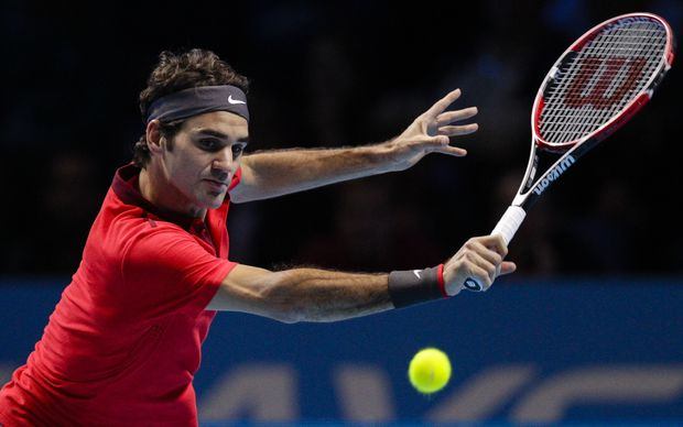 The Swiss tennis player Roger Federer in action.