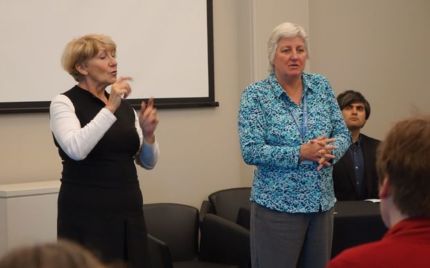 Southern DHB chief executive Carole Heatly, right, at the meeting last night with sign language interpreter Bridget Brown.