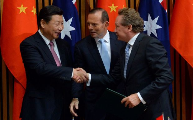 President of China Xi Jinping, Australian Prime Minister Tony Abbott and Fortescue Metals CEO Andrew Forrest after the signing of a framework for the free trade agreement in Canberra on Monday.
