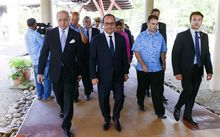 The French President, Francois Hollande, centre, and Foreign Minister, Laurent Fabius, left, arrive at the Secretariat for the Pacific Community in Noumea