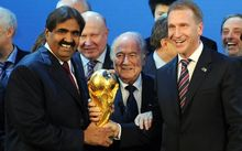 Sheikh Hamad bin Khalifa Al-Thani of Qatar, left, Fifa president Joseph Blatter and Russia's Deputy Prime Minister Igor Shuvalov celebrate the winning bids in 2010.