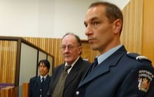 Stewart Murray Wilson (centre) at the Whanganui District Court in 2014.