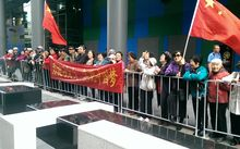 Supporters waving Chinese flags were metres away from a small group of Falun Gong protestors.