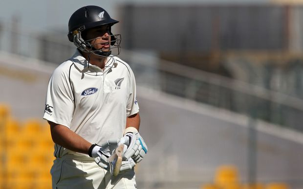 Ross Taylor walks back to the pavilion after his unbeaten 77