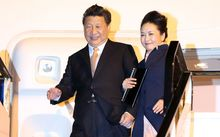 Xi Jinping and his wife Peng Liyuan as they arrived at Auckland International Airport.