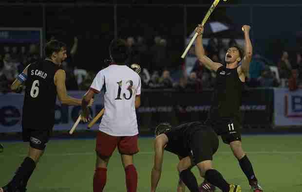 New Zealand hockey players Simon Child and Jacob Smith celebrate a goal against Japan 2014.