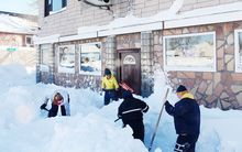 Workers trying to clear snow in Buffalo, New York.